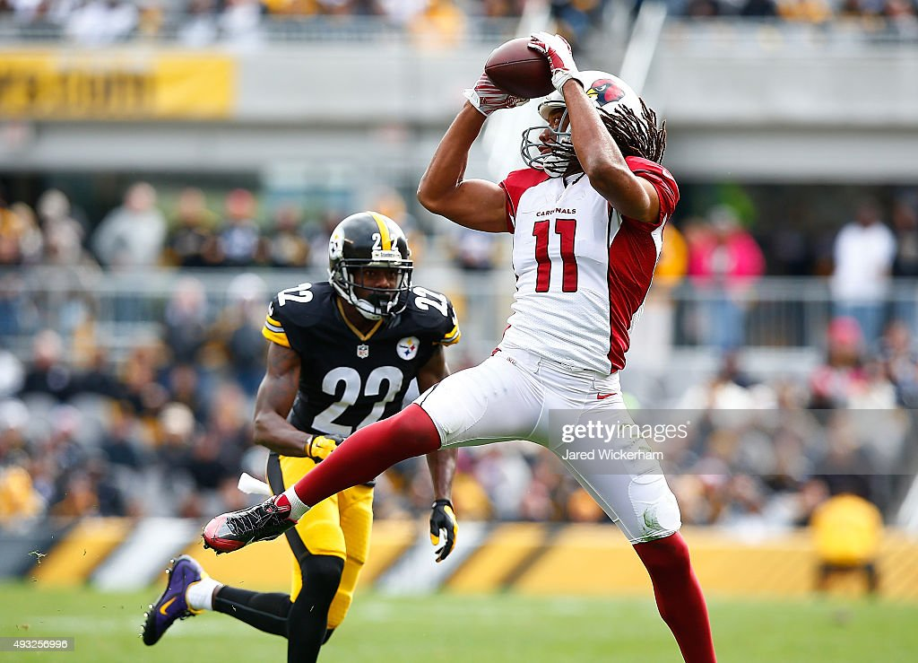 <a gi-track='captionPersonalityLinkClicked' href=/galleries/search?phrase=Larry+Fitzgerald&family=editorial&specificpeople=183380 ng-click='$event.stopPropagation()'>Larry Fitzgerald</a> #11 of the Arizona Cardinals catches a pass in front of <a gi-track='captionPersonalityLinkClicked' href=/galleries/search?phrase=William+Gay&family=editorial&specificpeople=2108843 ng-click='$event.stopPropagation()'>William Gay</a> #22 of the Pittsburgh Steelers during the 1st quarter of the game at Heinz Field on October 18, 2015 in Pittsburgh, Pennsylvania.