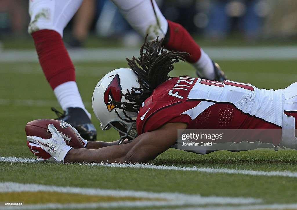 <a gi-track='captionPersonalityLinkClicked' href=/galleries/search?phrase=Larry+Fitzgerald&family=editorial&specificpeople=183380 ng-click='$event.stopPropagation()'>Larry Fitzgerald</a> #11 of the Arizona Cardinals dives over the goal line to score a touchdown against the Green Bay Packers at Lambeau Field on November 4, 2012 in Green Bay, Wisconsin. The Packers defeated the Cardinals 31-17.