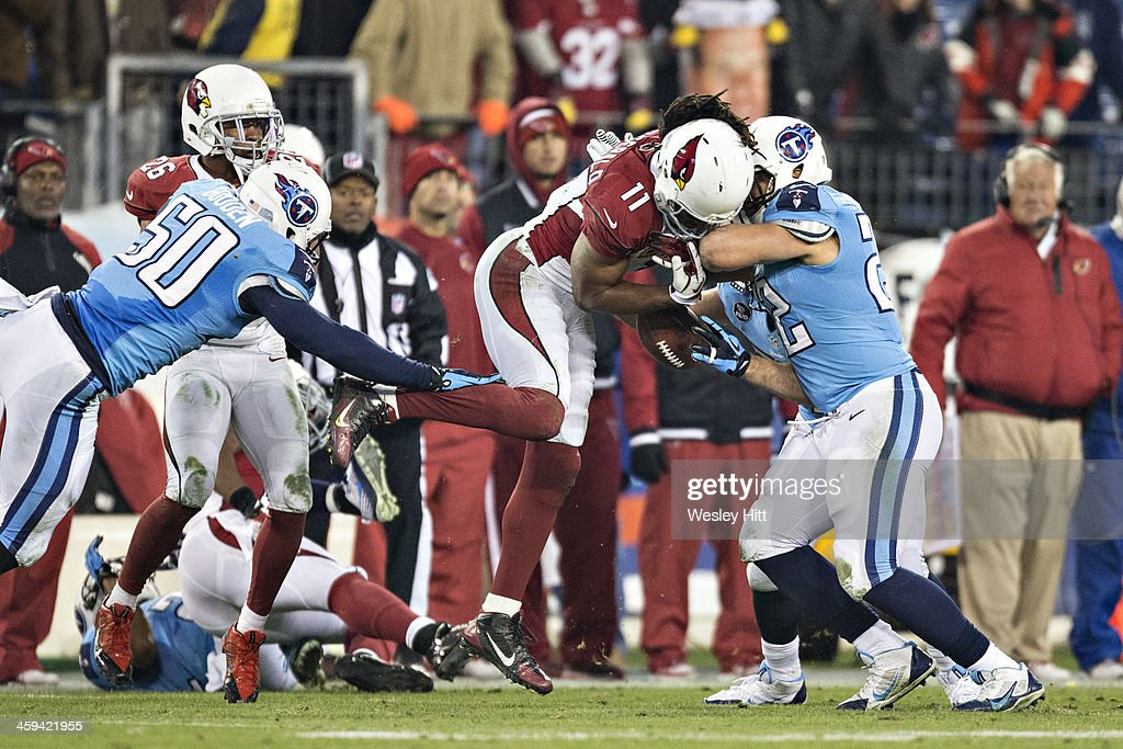 <a gi-track='captionPersonalityLinkClicked' href=/galleries/search?phrase=Larry+Fitzgerald&family=editorial&specificpeople=183380 ng-click='$event.stopPropagation()'>Larry Fitzgerald</a> #11 of the Arizona Cardinals jumps to get a on side kickoff but is hit and fumbles the ball by <a gi-track='captionPersonalityLinkClicked' href=/galleries/search?phrase=Jackie+Battle&family=editorial&specificpeople=2852926 ng-click='$event.stopPropagation()'>Jackie Battle</a> #22 of the Tennessee Titans at LP Field on December 15, 2013 in Nashville, Tennessee. The Cardinals defeated the Titans 37-34.
