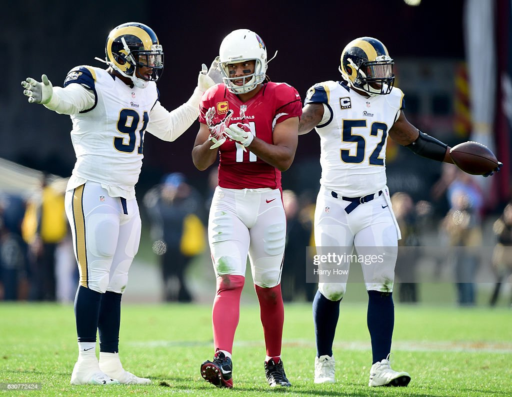 Larry Fitzgerald #11 of the Arizona Cardinals reacts to a pass interference call on Dominique Easley #91 of the Los Angeles Rams as Alec Ogletree #52 reacts during the first quarter at Los Angeles Memorial Coliseum on January 1, 2017 in Los Angeles, California.