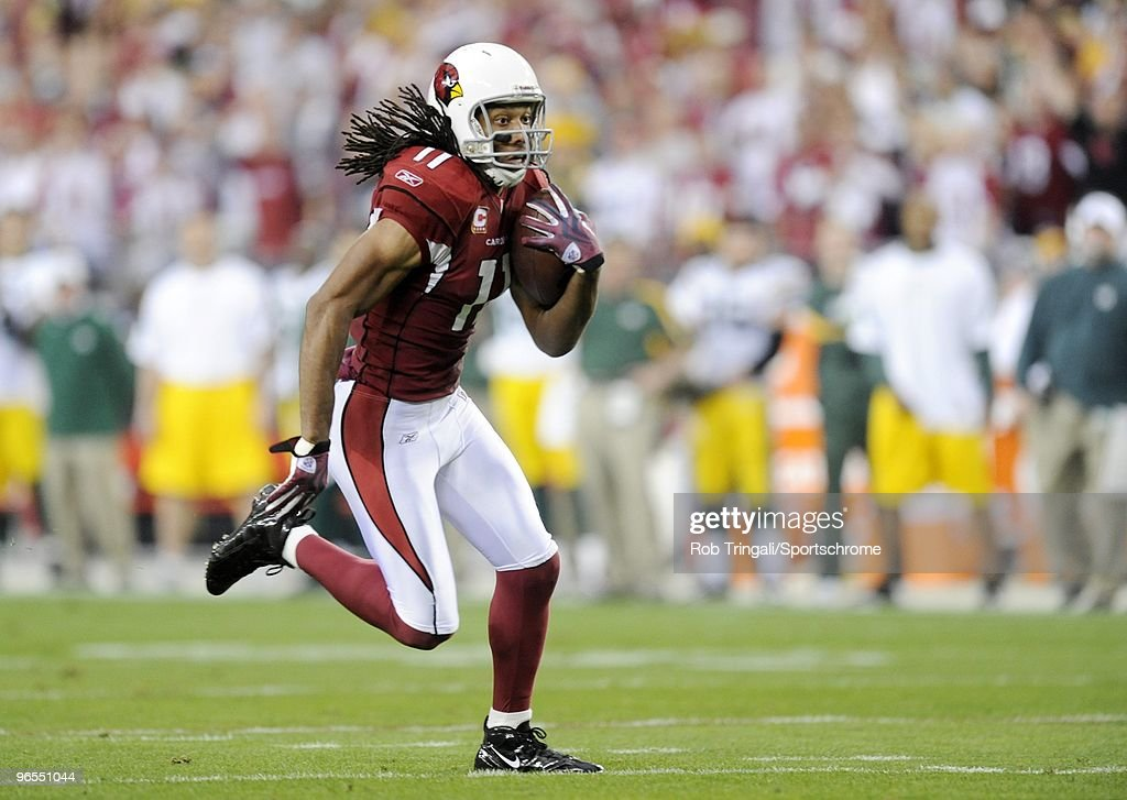 Larry Fitzgerald #11 of the Arizona Cardinals runs for a 33 yard touchdown in the third quarter against the Green Bay Packers in the NFC wild-card playoff game at University of Phoenix Stadium on January 10, 2010 in Glendale, Arizona. The Cardinals won the game 51-45 in overtime.