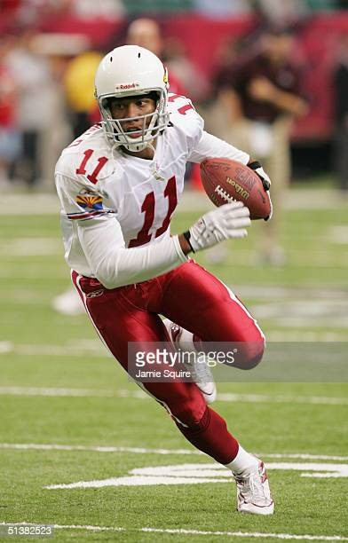 Larry Fitzgerald of the Arizona Cardinals runs for yardage during the game against the Atlanta Falcons at the Georgia Dome on September 26 2004 in...