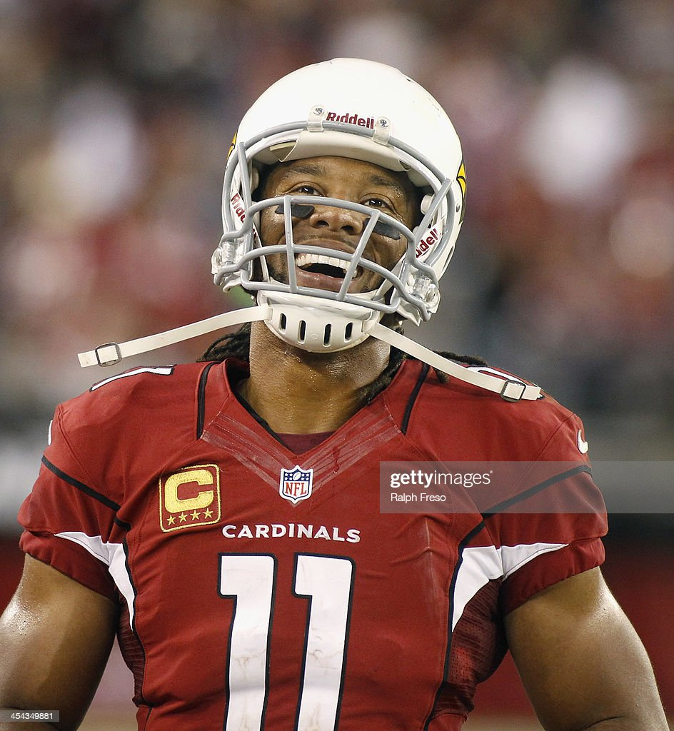 <a gi-track='captionPersonalityLinkClicked' href=/galleries/search?phrase=Larry+Fitzgerald&family=editorial&specificpeople=183380 ng-click='$event.stopPropagation()'>Larry Fitzgerald</a> #11 of the Arizona Cardinals smiles after the team scored a touchdown against the St Louis Rams during the fourth quarter of an NFL football game at University of Phoenix Stadium on December 8, 2013 in Glendale, Arizona.