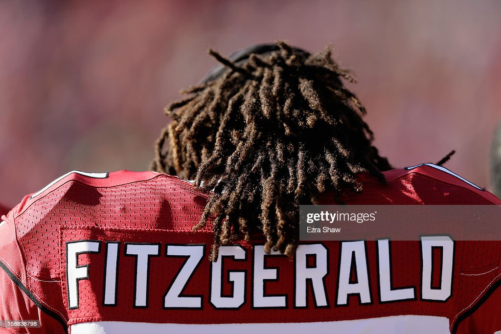Larry Fitzgerald #11 of the Arizona Cardinals stands on the sidelines before their game against the San Francisco 49ers at Candlestick Park on December 30, 2012 in San Francisco, California.