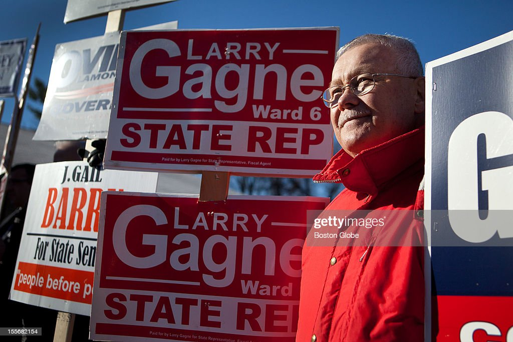 Larry Gagne, 68, poses for a portrait while standing outside holding signs in front of the voting location at St. Pius CCD Center in Manchester, New Hampshire on Election Day, November 6, 2012. Gagne voted for Romney, and is an Independent.