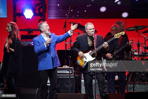 Larry Gatlin and Steve Gatlin of The Gatlins perform in concert during the 'Deep From The Heart One America Appeal Concert' at Reed Arena on October...