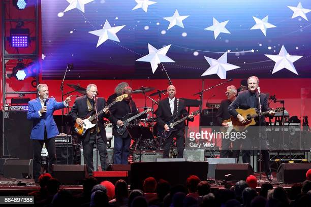 Larry Gatlin Steve Gatlin and Rudy Gatlin of The Gatlins perform in concert during the 'Deep From The Heart One America Appeal Concert' at Reed Arena...