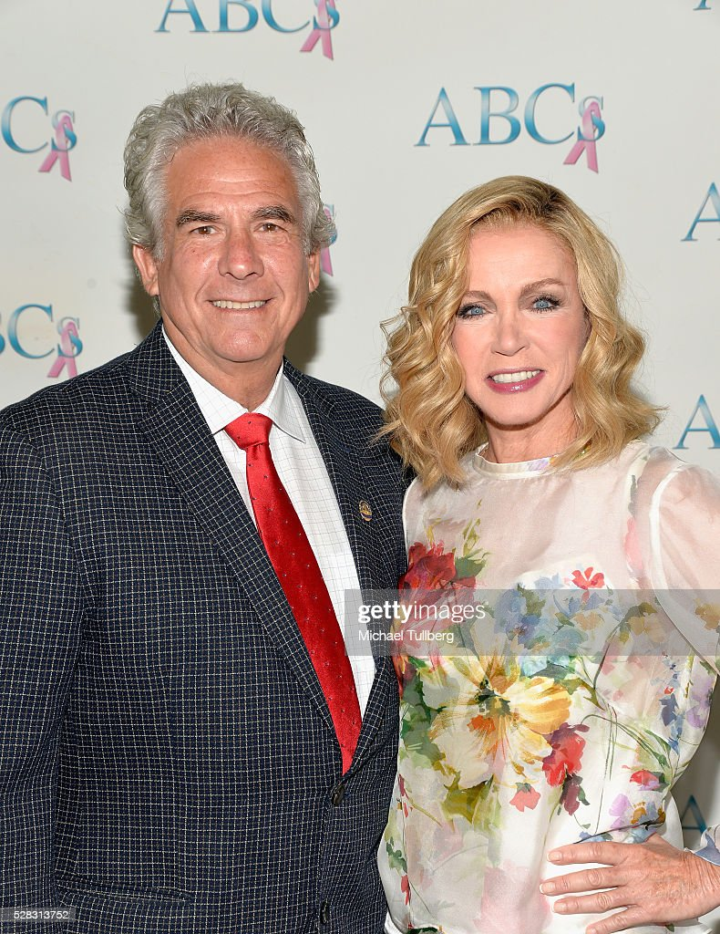 Richard Holland and actress <a gi-track='captionPersonalityLinkClicked' href=/galleries/search?phrase=Donna+Mills&family=editorial&specificpeople=217252 ng-click='$event.stopPropagation()'>Donna Mills</a> attend the Associates For Breast and Prostate Cancer Studies' annual Mother's Day Luncheon at Four Seasons Hotel Los Angeles at Beverly Hills on May 4, 2016 in Los Angeles, California.
