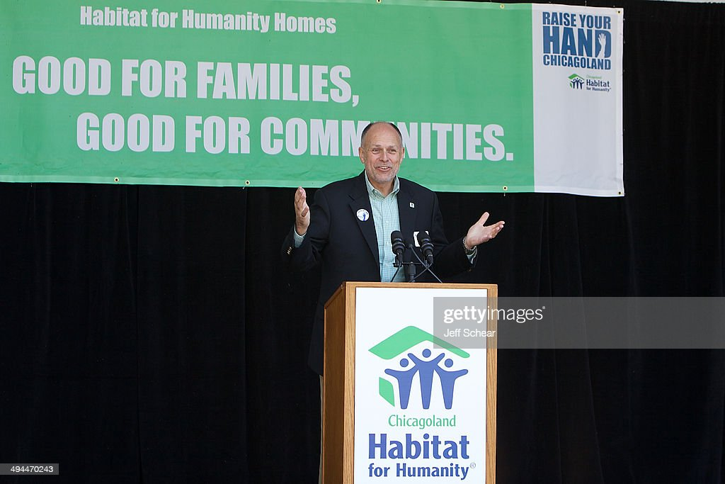 Larry Gluth, Senior VP of Habitat for Humanity International, helps kick off Habitat for Humanity's 'Raise Your Hand Chicagoland,' an unprecedented building blitz in the heart of downtown Chicago. From May 29 through June 1 at Pioneer Court Plaza, volunteers will come together with partner families to complete the initial construction of 13 homes. Immediately following, these new homes will be taken into communities across the region, where they will be finished and become a place 13 families can call their own. Those across the area are invited to attend 'Raise Your Hand Chicagoland' to tour a Habitat home, participate in family-friendly activities and learn more about Habitat for Humanity in Chicagoland, including future volunteer opportunities. Chicagoans can also show their support virtually using #RYHC and following Habitat for Humanity on Facebook, Twitter and Instagram (@ChicagoHabitat). For more information, visit chicagolandhabitat.org/RYHC.