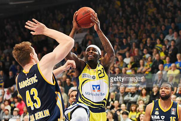Larry Gordon of Phoenix Hagen goes for two points under the pressure of Leon Radosevic of ALBA Berlin during the Beko BBL Basketball Bundesliga match...