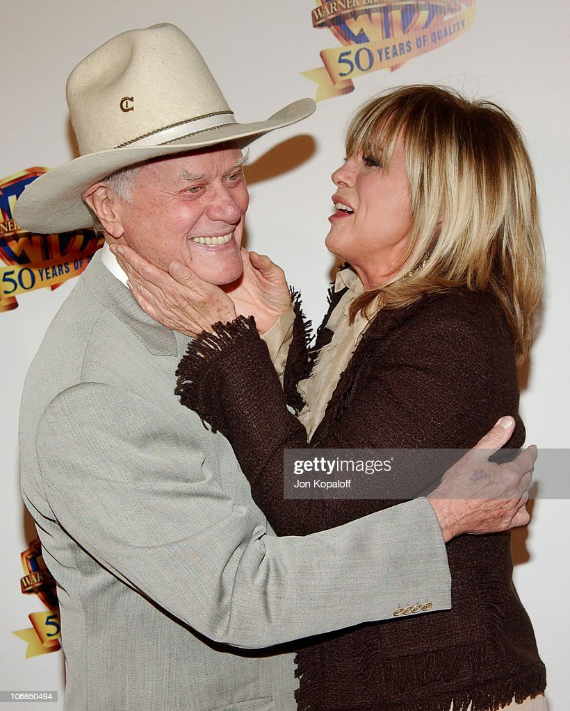 Larry Hagman and Linda Gray during Warner Bros. Television and Warner Home Video Celebrate 50 Years Of Quality TV - Arrivals at Warner Bros. Studios in Burbank, California, United States.
