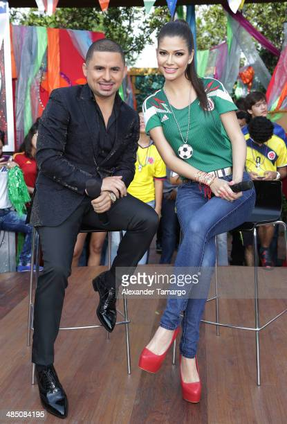 Larry Hernandez and Ana Patricia Gonzalez pose during FIFA World Cup Trophy Tour on the set of Despierta America at Univision Headquarters on April...