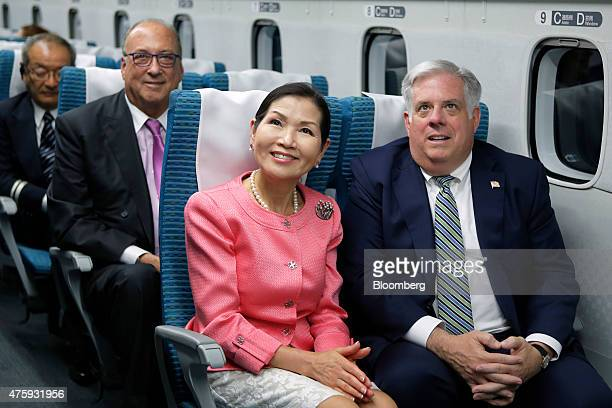 Larry Hogan governor of Maryland front right and his wife Yumi Hogan front left sit on board the L0 series magnetic levitation train developed by...