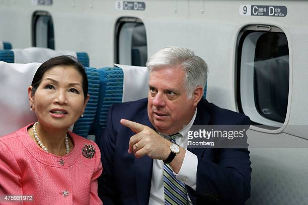 Larry Hogan governor of Maryland right and his wife Yumi Hogan sit on board the L0 series magnetic levitation train developed by Central Japan...