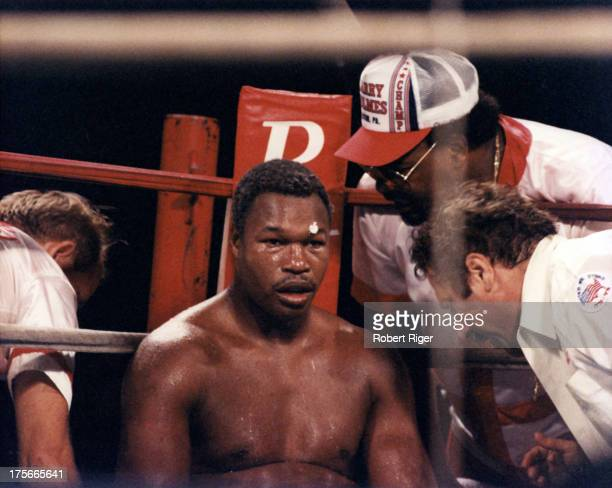 Larry Holmes sits in the corner between rounds against Michael Spinks during the heavyweight championship at Riviera Hotel Casino on September 21...