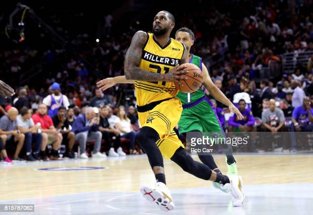 Larry Hughes drives to the basket against Mahmoud AbdulRauf of the 3 Headed Monsters during week four of the BIG3 three on three basketball league at...