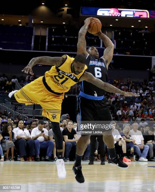 Larry Hughes of Killer 3s challenges Paul McPherson of Power during week two of the BIG3 three on three basketball league at Spectrum Center on July...