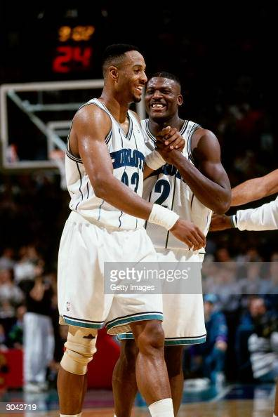Larry Johnson and Alonzo Mourning of the Charlotte Hornets celebrate after making a play during an NBA game circa 1993 at The Charlotte Coliseum in...