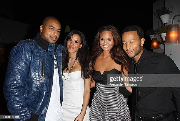Larry Johnson Julissa Bermudez Christine Teigen and John Legend pose at the Rush Philanthropic Arts Foundation VIP reception at the Delano Hotel on...