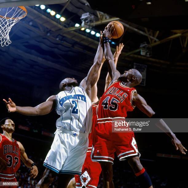 Larry Johnson of the Charlotte Hornets battles for a rebound against Michael Jordan of the Chicago Bulls in Game Two of the Eastern Conference...