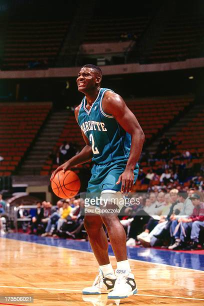 Larry Johnson of the Charlotte Hornets dribbles against the New Jersey Nets during a game played circa 1991 at Brendan Byrne Arena in East Rutherford...