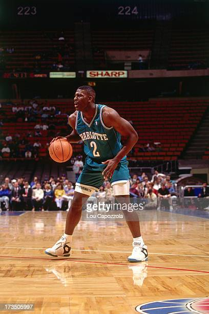 Larry Johnson of the Charlotte Hornets handles the ball against the New Jersey Nets during a game played circa 1991 at Brendan Byrne Arena in East...