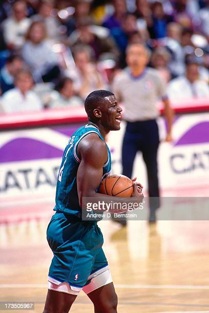 Larry Johnson of the Charlotte Hornets holds the ball during a game against the Los Angeles Clippers played circa 1991 at the Los Angeles Memorial...
