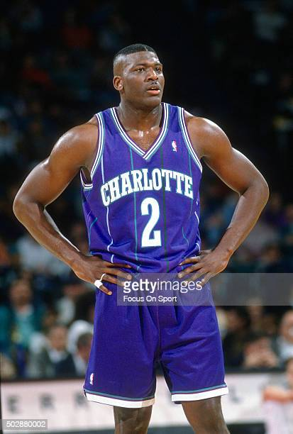 Larry Johnson of the Charlotte Hornets looks on against the Washington Bullets during an NBA basketball game circa 1995 at the US Airways Arena in...