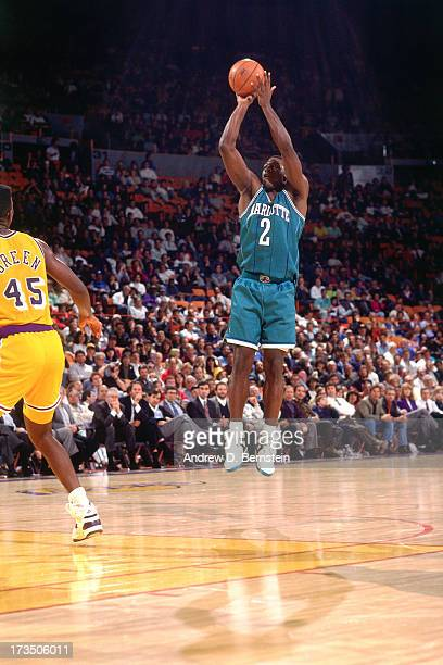 Larry Johnson of the Charlotte Hornets shoots against AC Green of the Los Angeles Lakers during a game played circa 1991 at the Great Western Forum...