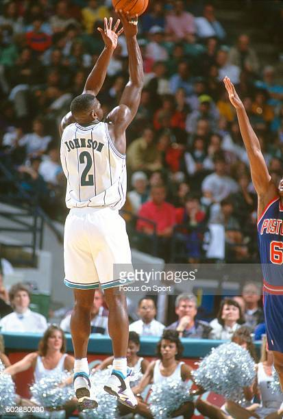 Larry Johnson of the Charlotte Hornets shoots over Terry Mills of the Detroit Pistons during an NBA basketball game circa 1993 at the Charlotte...