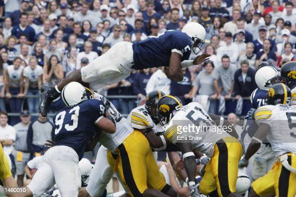 Larry Johnson of the Penn State leaps over the line for a touchdown in the third quarter of the game against Iowa on September 28 2002 at Beaver...