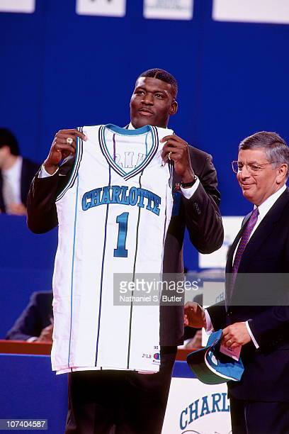 Larry Johnson shakes hands with NBA Commissioner David Stern after being selected first overall by the Charlotte Hornets during the 1991 NBA Draft at...