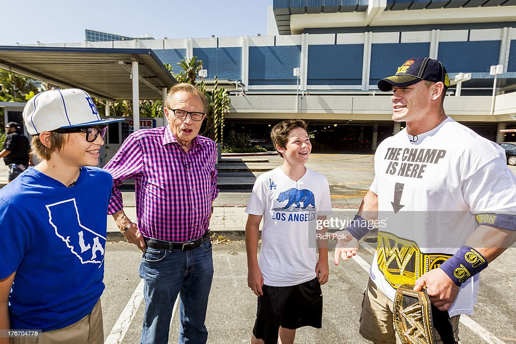 <a gi-track='captionPersonalityLinkClicked' href=/galleries/search?phrase=Larry+King&family=editorial&specificpeople=202014 ng-click='$event.stopPropagation()'>Larry King</a> and his sons are greeted by <a gi-track='captionPersonalityLinkClicked' href=/galleries/search?phrase=John+Cena&family=editorial&specificpeople=644116 ng-click='$event.stopPropagation()'>John Cena</a> at WWE Superstar <a gi-track='captionPersonalityLinkClicked' href=/galleries/search?phrase=John+Cena&family=editorial&specificpeople=644116 ng-click='$event.stopPropagation()'>John Cena</a> runs into Scooby backstage at Summerslam's Fan Axxess. The two will reunite this spring in WWE Studios & Warner Bros. Scooby-Doo! WrestleMania Mystery at Summer Slam 2013.' on August 17, 2013 in Los Angeles, California.