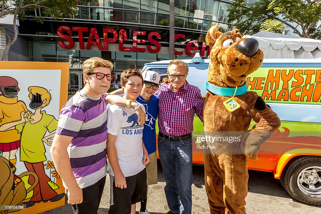 Larry King and his sons pose for a photo at WWE Superstar John Cena runs into Scooby backstage at Summerslam's Fan Axxess. The two will reunite this spring in WWE Studios & Warner Bros. Scooby-Doo! WrestleMania Mystery at Summer Slam 2013.' on August 17, 2013 in Los Angeles, California.