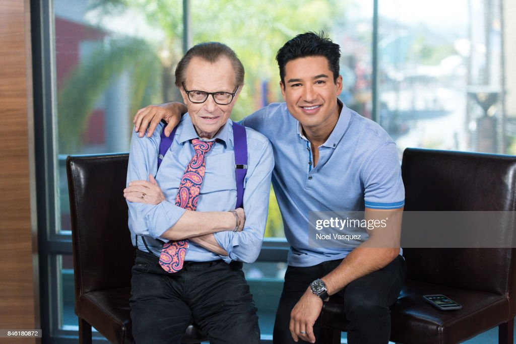 Larry King (L) and Mario Lopez visit 'Extra' at Universal Studios Hollywood on September 12, 2017 in Universal City, California.