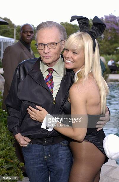 Larry King poses with a Playboy Playmate at the 'A Time To Care Gala' on May 13 2004 at the Playboy Mansion in Holmby Hills California The gala is to...