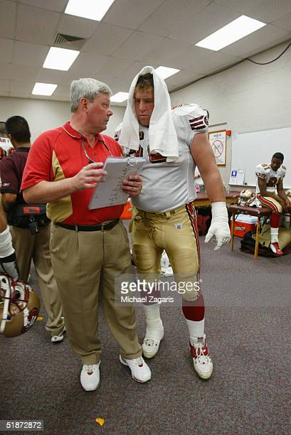 Larry MacDuff and Brock Gutierrez of the San Francisco 49ers go over plays in the locker room before the game against the Arizona Cardinals at Sun...