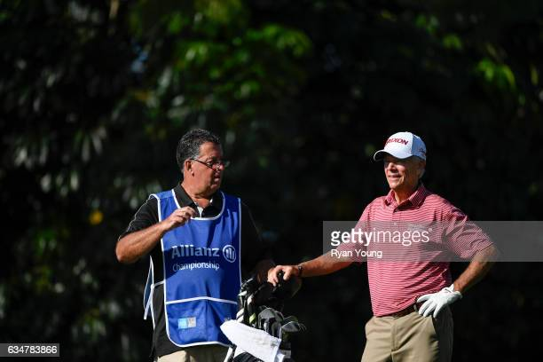 Larry Mize discusses his tee shot with his caddy before he tees off on the 16th hole during the second round of the PGA TOUR Champions Allianz...