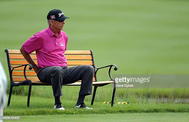 Larry Mize does some stretching on the 18th hole tee box during the first round of the 3M Championship at TPC Twin Cities on August 1 2014 in Blaine...