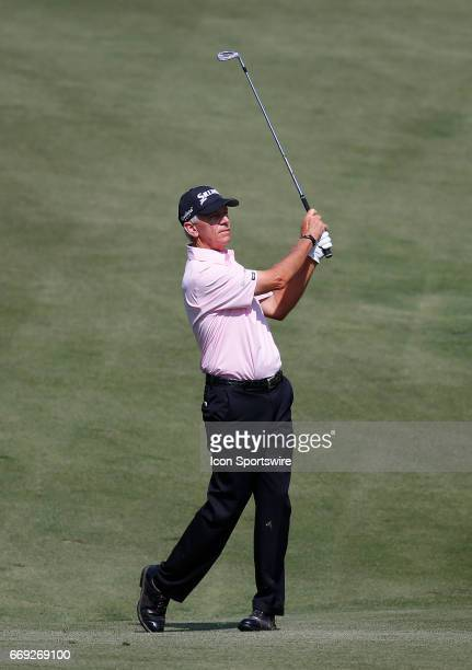 Larry Mize hits his approach shot to the 18th green during the final round of the Mitsubishi Electric Classic tournament at the TPC Sugarloaf Golf...