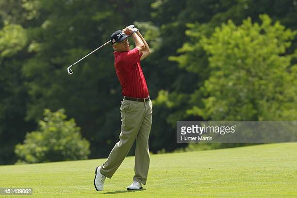 Larry Mize hits his second shot on the second hole during the third round of the Constellation Senior Players Championship at Fox Chapel Golf Club on...