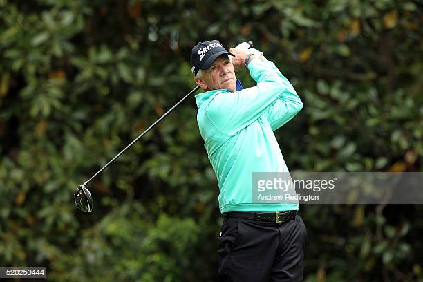 Larry Mize of the United States plays his shot from the 11th tee during the final round of the 2016 Masters Tournament at Augusta National Golf Club...
