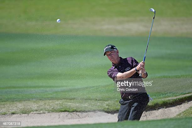 Larry Mize plays from a bunker on the 10th hole during the first round of the Champions Tour Tucson Conquistadores Classic at Omni Tucson National on...