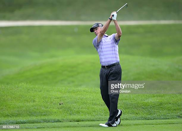 Larry Mize plays his second shot on the 16th hole during the first round of the Constellation SENIOR PLAYERS Championship at Fox Chapel Golf Club on...