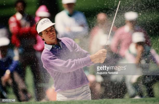 Larry Mize watches his shot from the bunker during the 1988 Masters Tournament at Augusta National Golf Club in April 1988 in Augusta Georgia