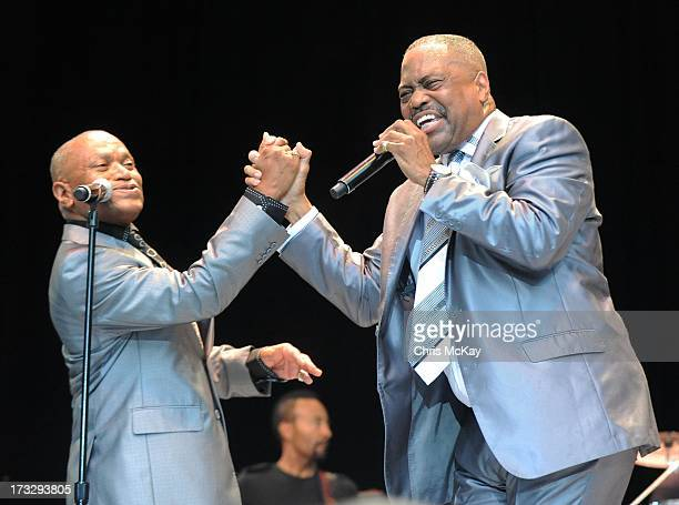Larry Moore and Cuba Gooding Sr of The Main Ingredient perform at Chastain Park Amphitheater on July 10 2013 in Atlanta Georgia