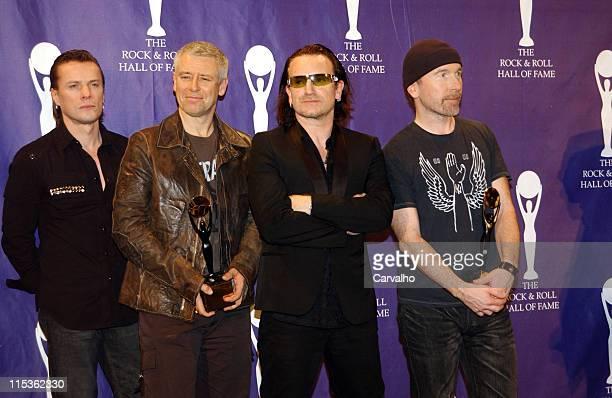 Larry Mullen Jr Adam Clayton Bono and The Edge of U2 inductees