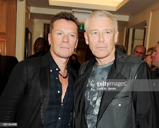 Larry Mullen Jr and Adam Clayton of Greatest Act Of The Last 25 Years Winner U2 pose in the press room at the Q Awards 2011 held at The Grosvenor...