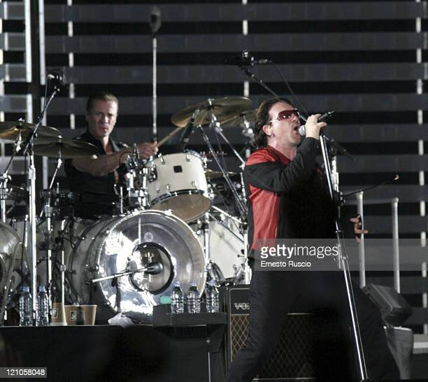 Larry Mullen Jr and Bono of U2 during U2 'Vertigo' Tour at Stadio Olimpico in Rome July 23 2005 at Stadio Olimpico in Rome Italy
