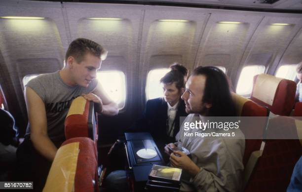 Larry Mullen Jr and The Edge from U2 are photographed on a plane during the Amnesty International tour in 1986 CREDIT MUST READ Ken Regan/Camera 5...